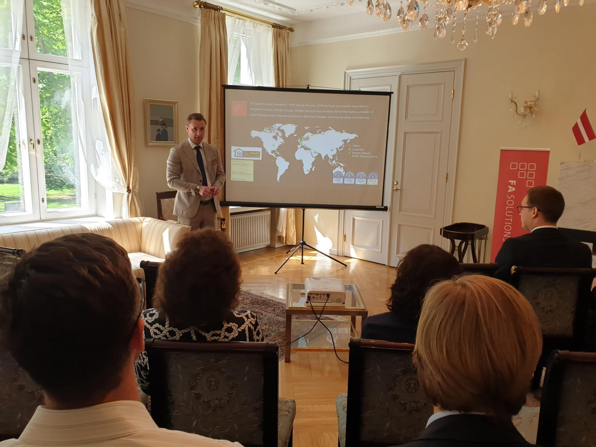 Hannes Helenius presenting at the Finnish Embassy in Riga, May 2019